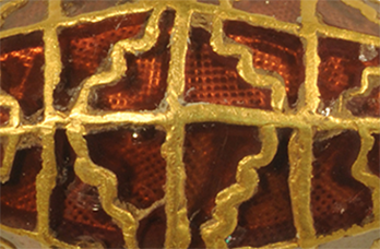 close up image of gold and garnet bead found at Rendlesham
