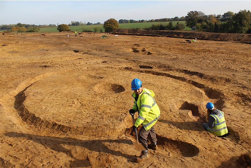 excavation site at Easton with two people excavating a round house