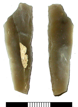 a broken retouched grey flint point, 4.5cm in length