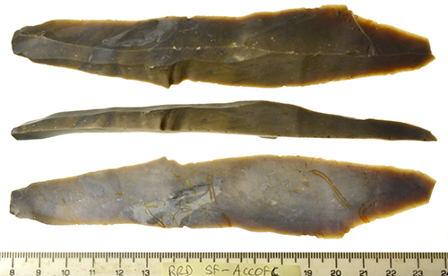 a Long grey flint blade (16cm in length) with a flake scar running along the dorsal side