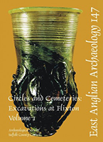 front cover with photo of green glass claw beaker