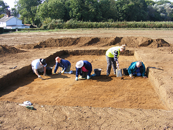 people excavating an archaeological site